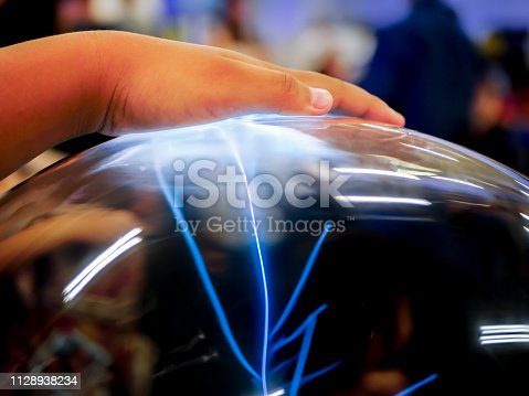 istock Electrical power in the hand 1128938234