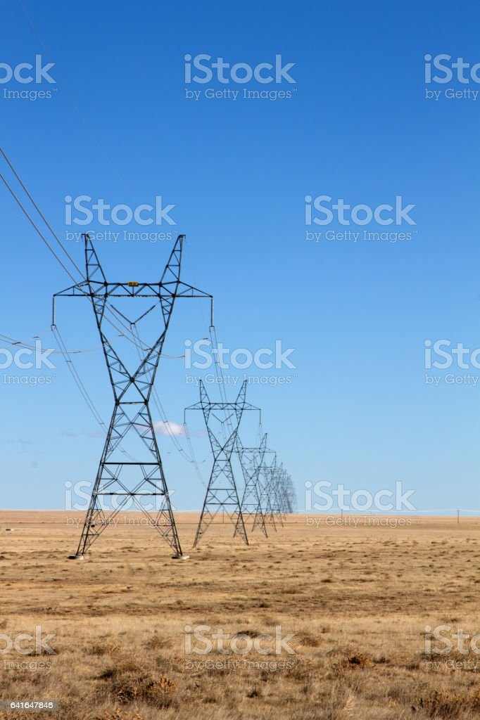 Electrical Power Lines under a blue sky stock photo