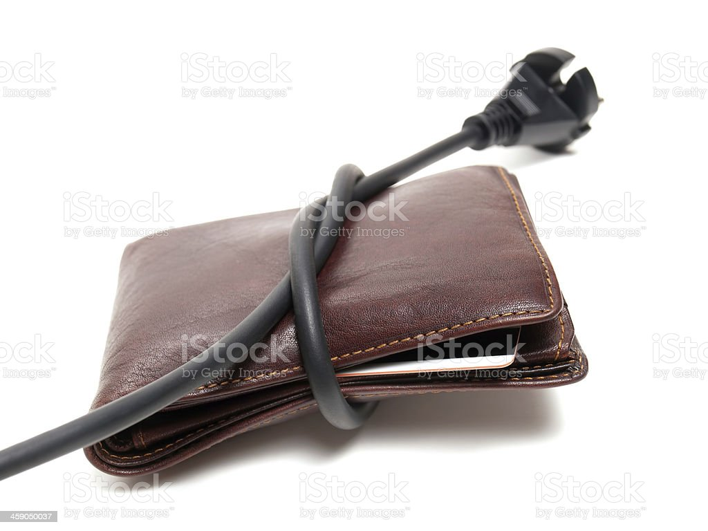 Electrical power wire wrapped around a brown leather wallet stock photo