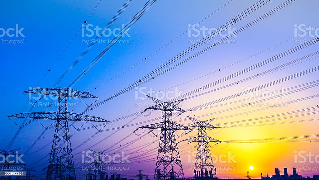 Electrical Pylons near Jabel Ali, Dubai, United Arab Emirates stock photo