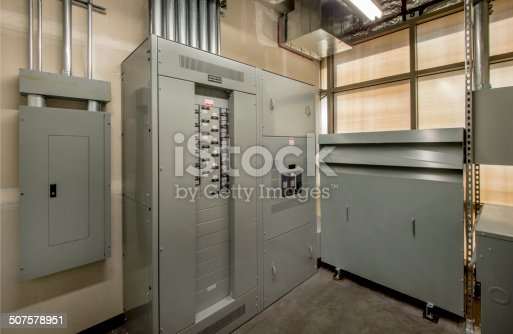 Transformer and control panel in the electrical room of a large office building.