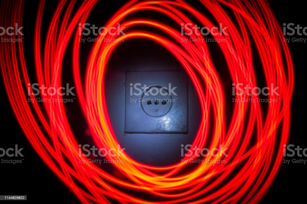 Electrical socket with fractal circles of light painted around it....