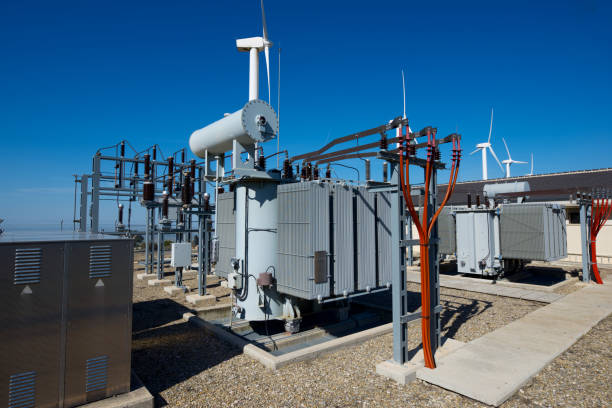 Electrical substation and windmills windmills for removable energy production and electrical substation, El Buste, Zaragoza, Aragon, Spain electricity transformer stock pictures, royalty-free photos & images