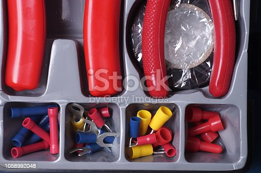 Electrical tool kit containing a five funtion multi-tool, needle nose pliers, Phillips screwdriver, slotted screwdriver, Neon circuit tester, electrical tape, connectors and terminals, all in a plastic box.