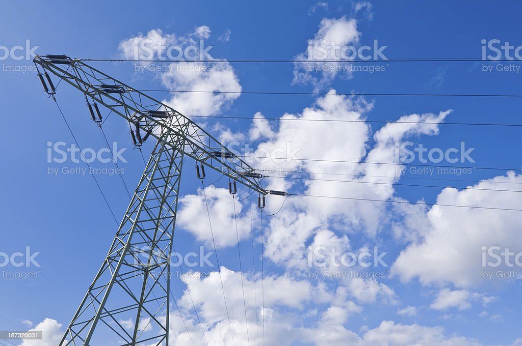 Electrical tower, blue sky and clouds stock photo