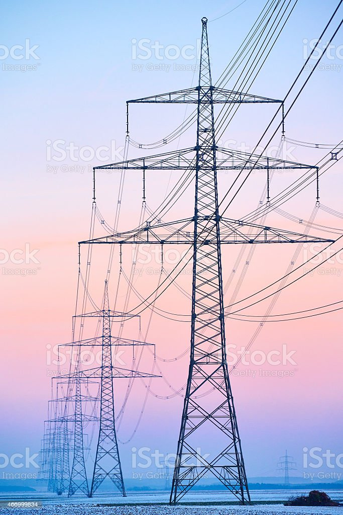 Electrical tower power pole in great sunset stock photo