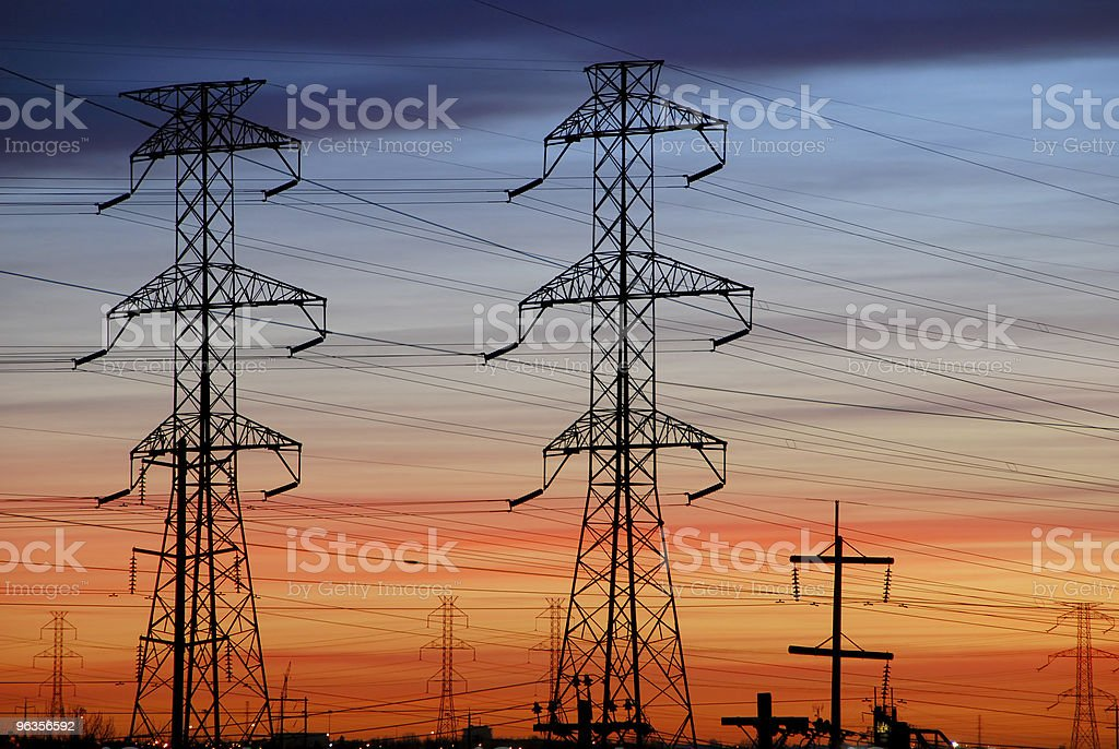 Electrical Towers with Colored Sky royalty-free stock photo