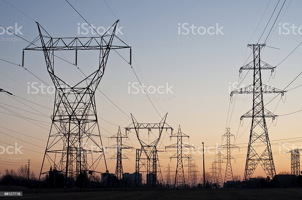 Electrical Transmission Towers (Electricity Pylons) at Sunset royalty-free stock photo