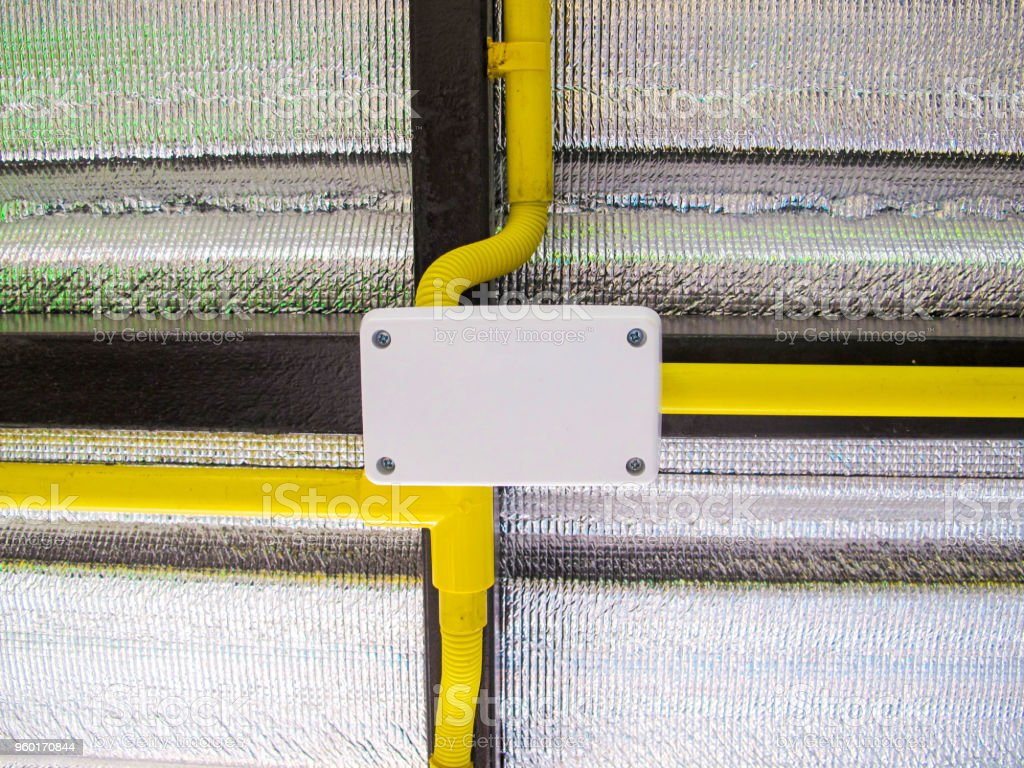Electrical Wiring In Yellow Pipe With Aluminum Heat Shield Stock ...
