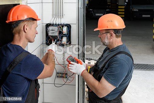 1142476659 istock photo Electrical work indoors. 1219405849
