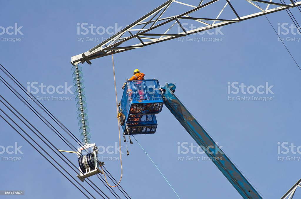 Electrical Worker building Electricity Pylon royalty-free stock photo