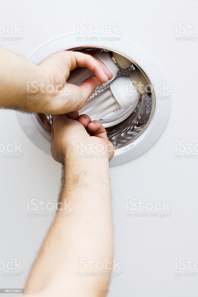 Electrician Assembling Light stock photo