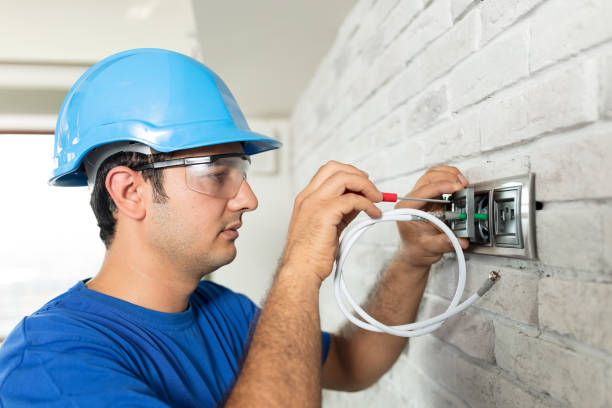 Electrician at work Electrician at cable wiring work cable tv stock pictures, royalty-free photos & images