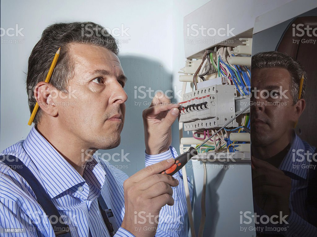 electrician at work stock photo