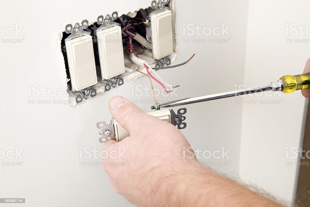electrician attaching ground wire to new residential light switch stock photo download image now ground rod home phone wiring wiring diagram