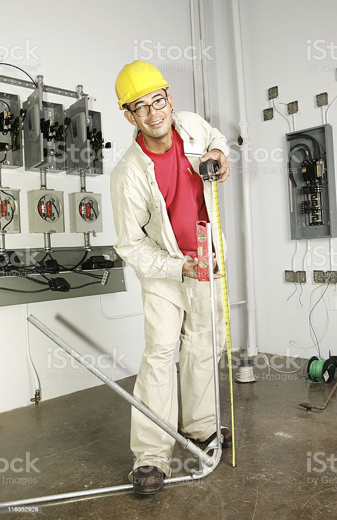 Electrician Bending Pipe royalty-free stock photo