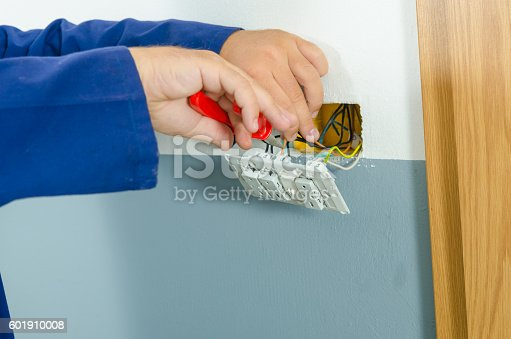 693910734 istock photo Electrician changed the switch 601910008