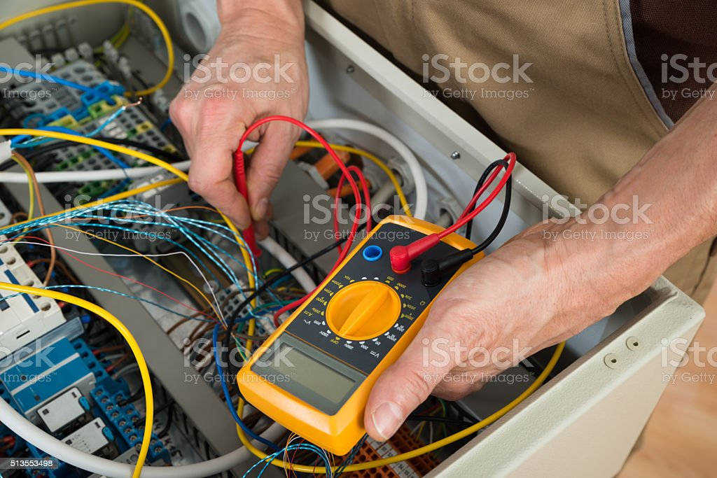 Electrician Checking A Fuse Box stock photo