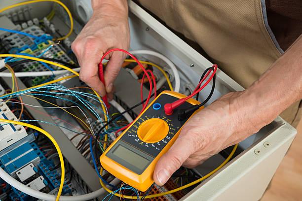 Electrician Checking A Fuse Box stock photo