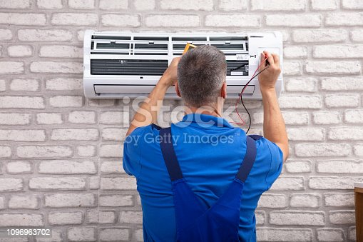 istock Electrician Checking Air Conditioner 1096963702
