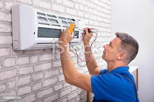 istock Electrician Checking Air Conditioner 1096963704