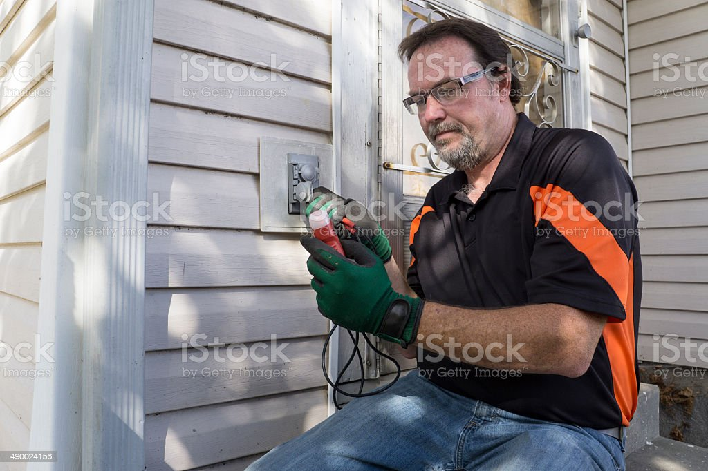 Electrician Checking Outside Outlet For Customer stock photo