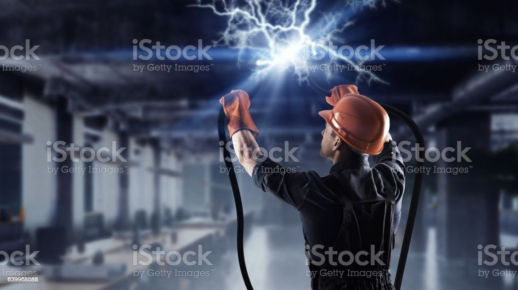 Electrician connecting cable . Mixed media stock photo