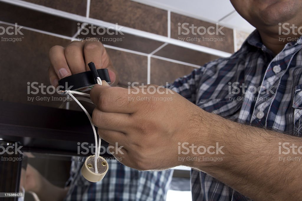 Electrician Connecting Wires stock photo