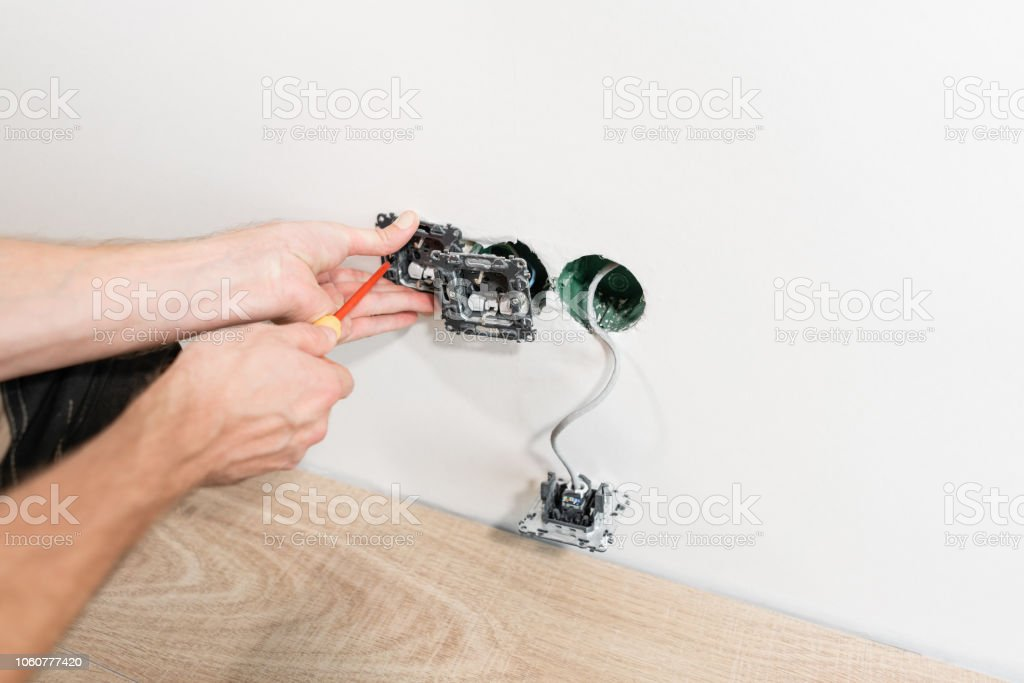 Astonishing Electrician Connects The Sockets To The Electrical Wires On Wall In Wiring Digital Resources Bemuashebarightsorg