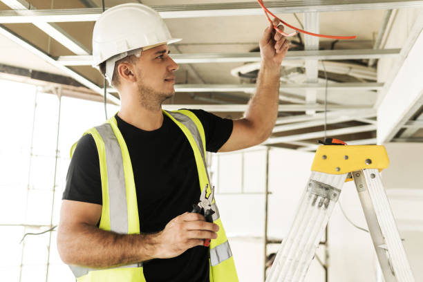 Electrician cutting wires during his work stock photo