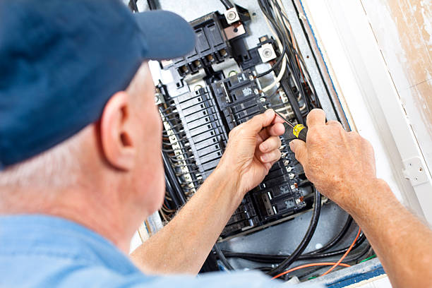 electrician doing electrical work in breaker box - fuse box stock photos and pictures