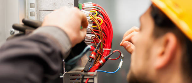 Electrician engineer tests electrical installations on relay protection system Electrician engineer tests electrical installations and wires on relay protection system. Bay control unit. Medium voltage switchgear electricity stock pictures, royalty-free photos & images