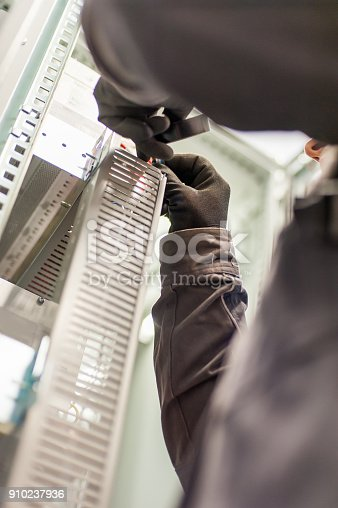 istock Electrician engineer tests electrical installations on relay protection system 910237936
