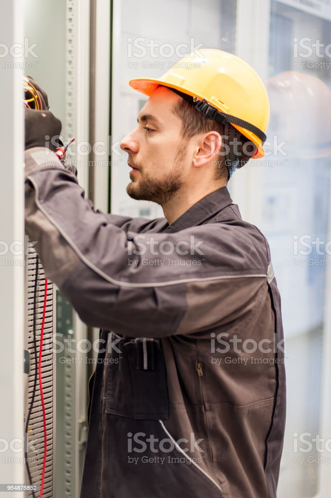 Electrician Engineer Tests Electrical Installations On