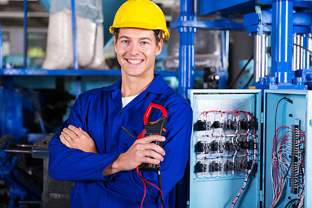electrician holding digital insulation tester stock photo