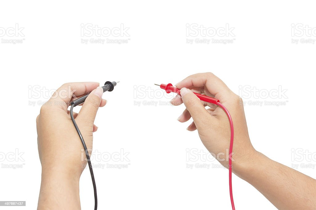 Electrician holding probes from voltmeter stock photo