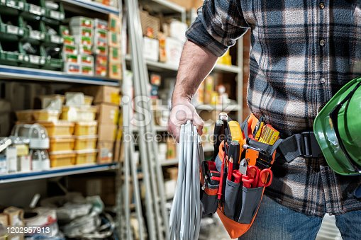 istock Electrician in the store of electrical components. Electricity. 1202957913
