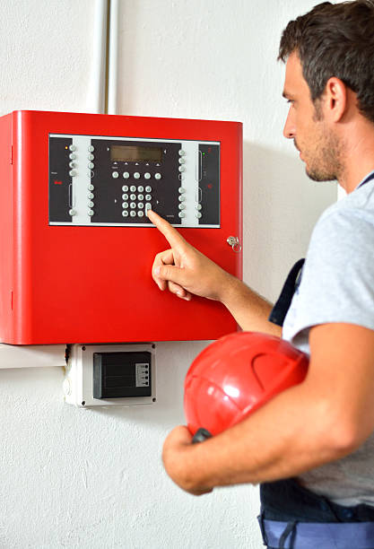 Electrician  inspect the Fire Alarm System. stock photo