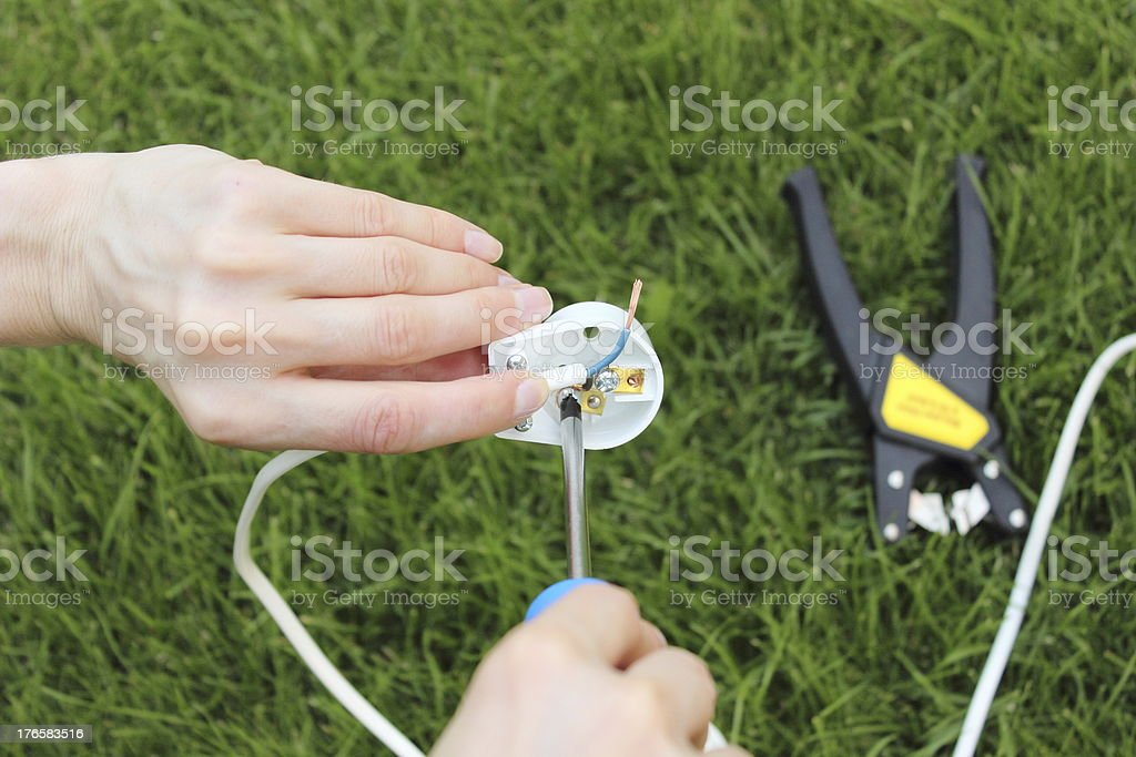 Electrician installing a power plug royalty-free stock photo