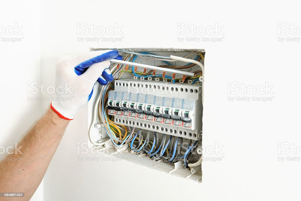 electrician installing an electrical fuse box  royalty-free stock photo