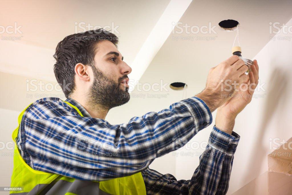 Electrician installing bulb stock photo
