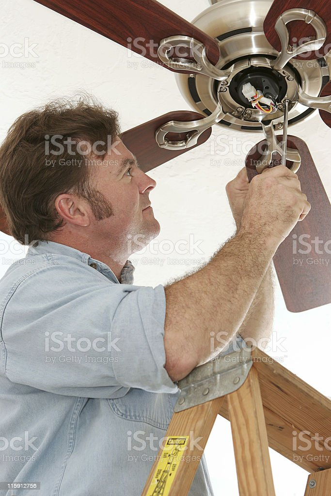 Electrician Installing Ceiling Fan Stock Photo