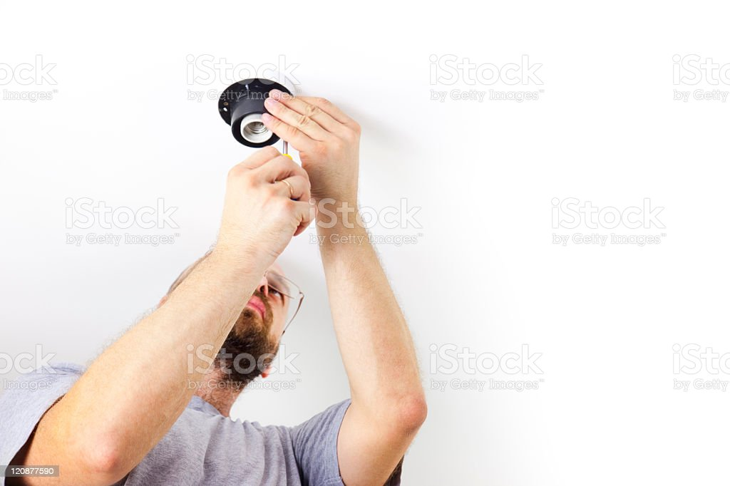 Electrician installing ceiling light stock photo