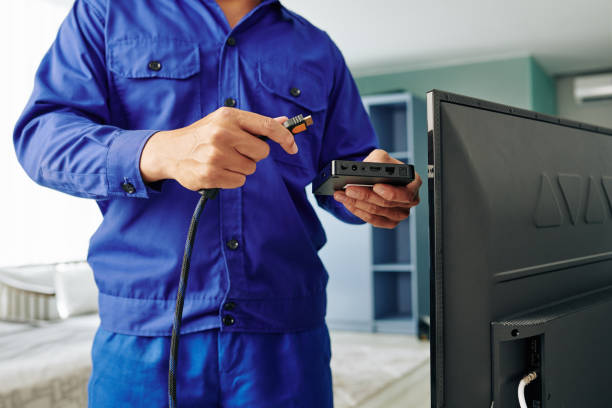Electrician installing digital tv receiver stock photo