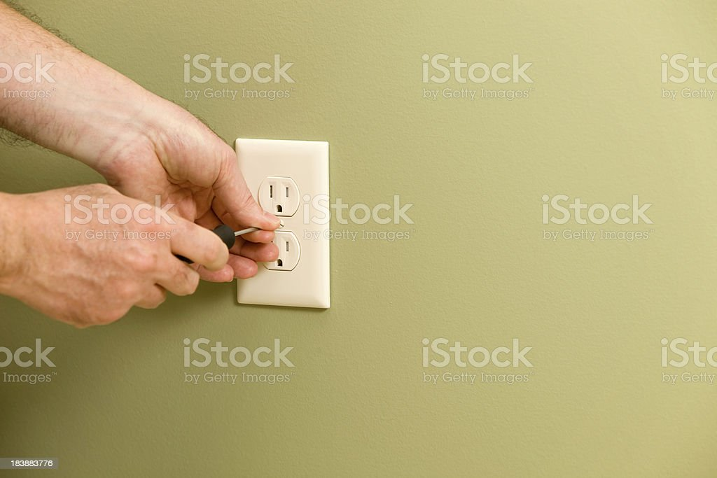 Electrician Installing Electric Outlet Cover stock photo
