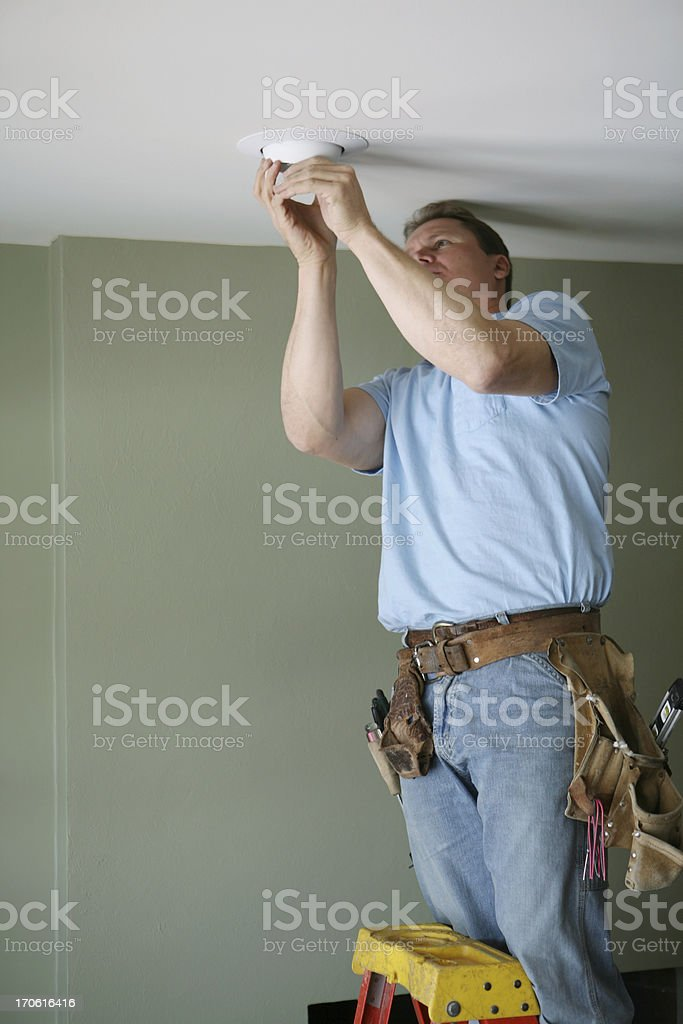 Electrician Installing Eyeball Light royalty-free stock photo