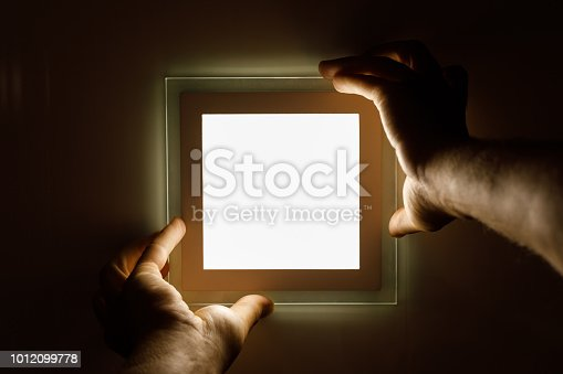 istock electrician installs an LED light 1012099778