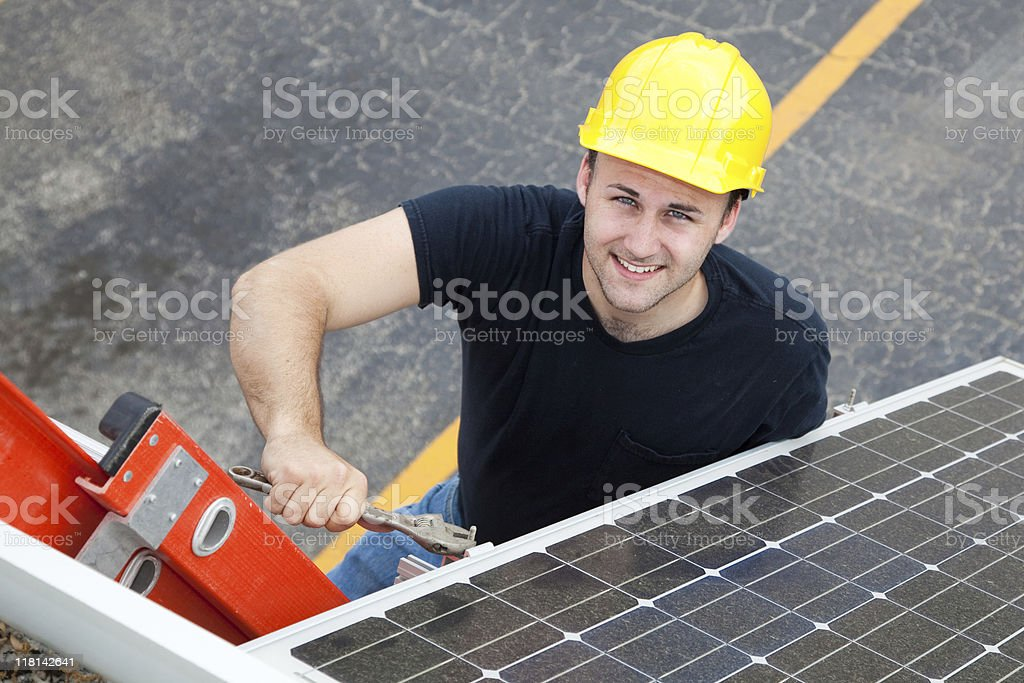 Electrician Installs Solar Panel royalty-free stock photo