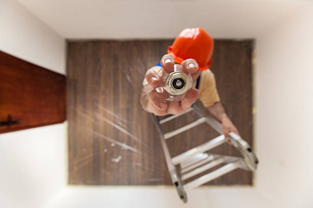 Electrician Is Mounting A New Bulb stock photo
