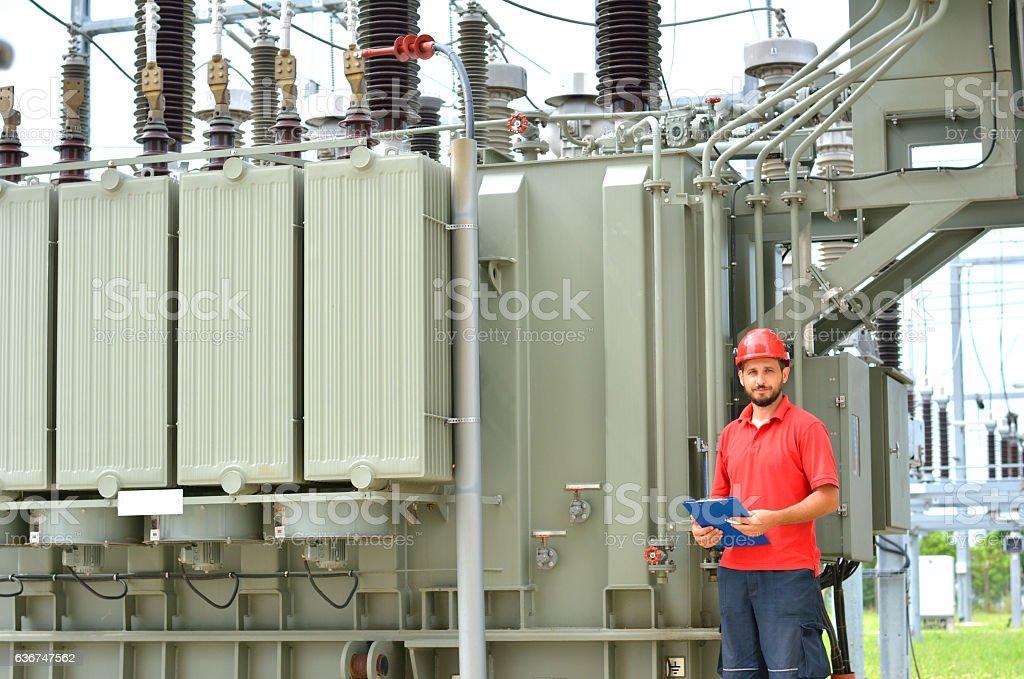Electrician Near High Voltage Transformer stock photo